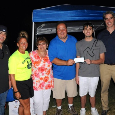 Logan Ippoliti of Ossining receives check for medical expenses. Pictured left to right  are Board Member Bobby Nolan, Advisors Robin Pell and Donna Cascone, Matt Gullotta, Logan and Advisor Chris Soi